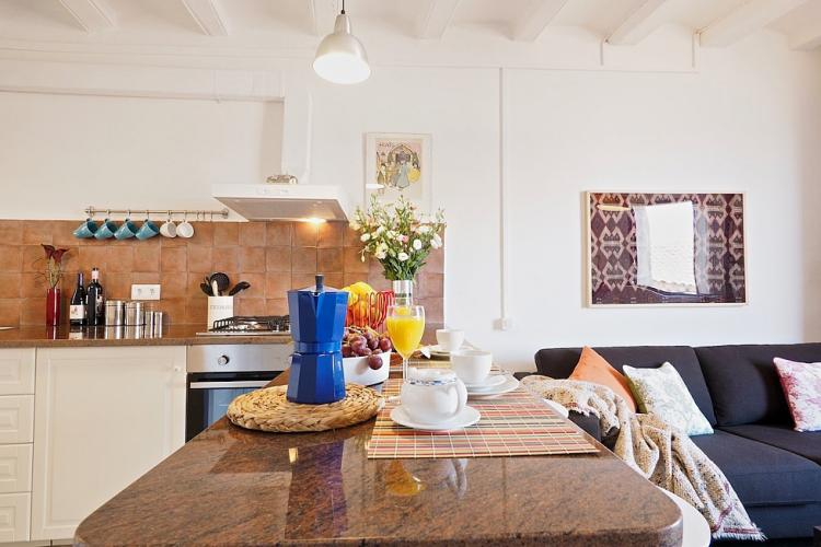 The kitchen is visually separated from the rest of the space by a breakfast bar.