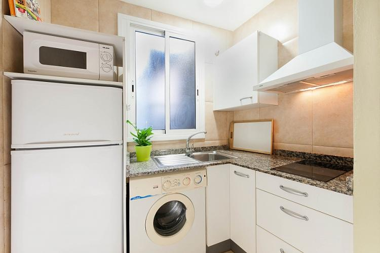 Basic but fully equipped kitchen perfect for preparing meals throughout your stay.